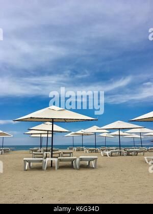 ... Umbrellas And Lounge Chair On The Beach   Stock Photo