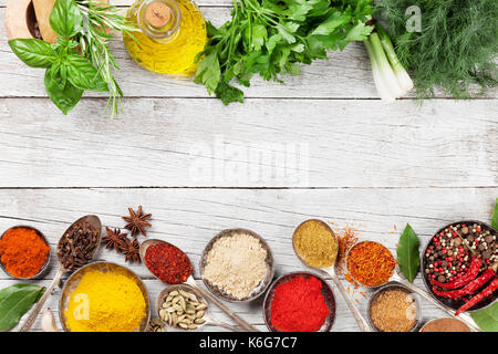 Various spices and herbs on wooden table. Top view with space for your text - Stock Photo