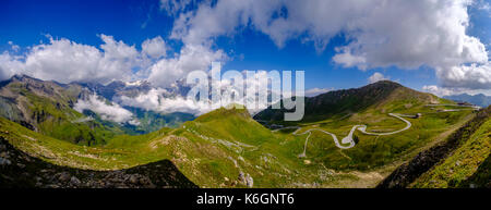 Panoramic aerial view down into the cloudy Salzach Valley and to Edelweissspitze viewpoint from the top of Grossglockner - Stock Photo