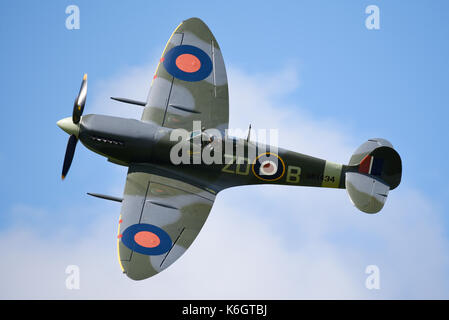 Supermarine Spitfire IX MH434 flying at the Goodwood Revival 2017. Space for copy - Stock Photo