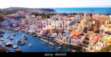 Panoramic view of the old village of fishermen's houses and the marina of Corricella, a classic panoramic view of - Stock Photo