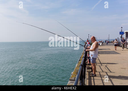 People enjoy sunny day on the Southend Pier, Southend-on-Sea, Essex, England, United Kingdom, UK - Stock Photo