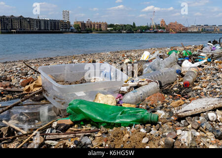 Plastic pollution on the bank of the River Thames, London England United Kingdom UK - Stock Photo