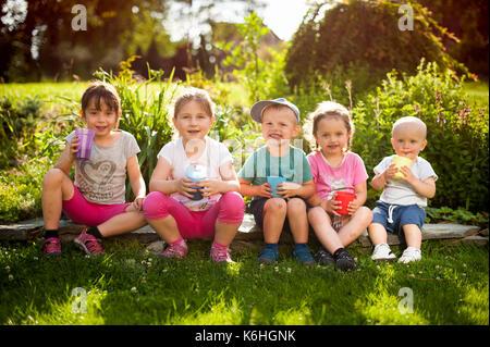 sibling enjoing summer - Stock Photo