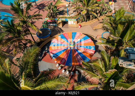 Aerial view of amusement park, rides, and arcade on promenade of Golden Mile in Durban, South Africa - Stock Photo