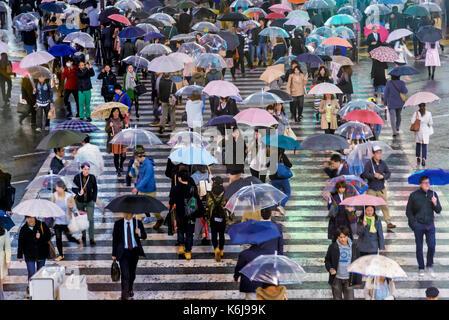 Tokyo, Japan - April 21, 2014: Pedestrians crossing the famous scramble crosswalk in Shibuya special ward - Stock Photo