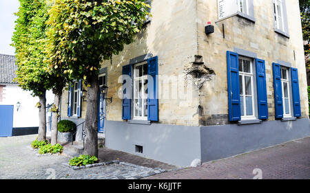 A house in Valkenburg, in the southern Netherlands province of Limburg, preserves damage from a bomb blast or anti - Stock Photo