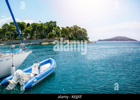 Boat on the water, left in the harbor at sea - Stock Photo