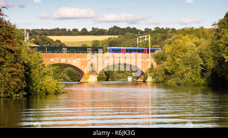 Reading, England, UK - August 29, 2016: Thames Turbo diesel multiple units crossing the River Thames at Goring in - Stock Photo