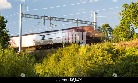 Reading, England, UK - August 29, 2016: A Crosscountry Voyager train at Goring in Berkshire, under new electrification - Stock Photo