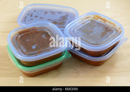 Batch of cooked turkey spaghetti sauce pit in storage containers for freezing for quick future meals - Stock Photo