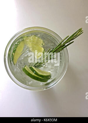 Classic Gin and Tonic cocktail with lime, lemon & rosemary - Stock Photo