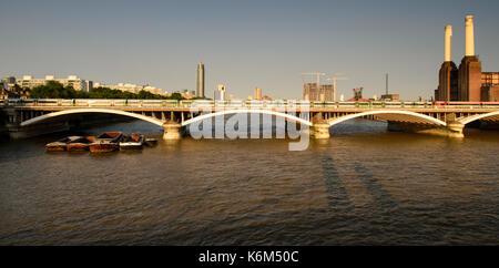 London, England, UK - July 9, 2013: Southern Trains cross the River Thames on the Grosvenor Bridge into London's - Stock Photo
