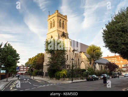 London, England, UK - September 29, 2016: Evening sun illuminates the tower and west face of Holy Trinity With St - Stock Photo