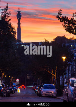 London, England, UK - October 18, 2016: The BT Tower is silhouetted against the sunset viewed from Wharton Street - Stock Photo