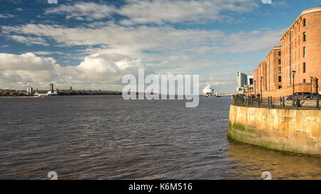 Liverpool, England, UK - November 11, 2016: Sun shines on the redeveloped Albert Dock warehouses in Liverpool's - Stock Photo