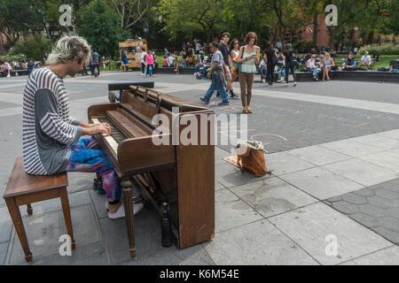 New York, NY 12 September 2017 - Piano busker in Washington Square Park - Stock Photo