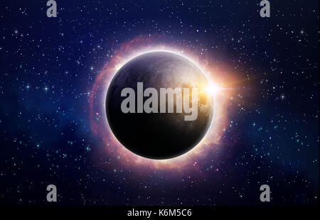 Full eclipse of the sun, surrounded by solar flares, in deep space - Stock Photo