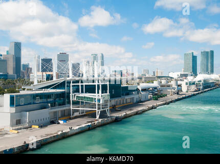 The view of cruise ship terminal buildings with Miami downtown in a background (Florida). - Stock Photo
