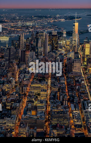 Freedom Tower WTC Aerial View - Aerial view during the last light after sunset to lower Manhattan and the One World - Stock Photo