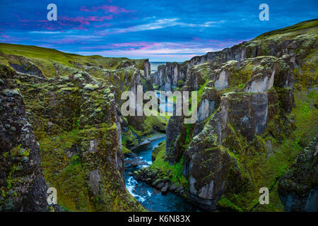 Fjaðrárgljúfur is a canyon in south east Iceland which is up to 100 m deep and about 2 kilometers long, with the Fjaðrá river flowing through it .The
