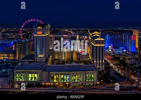 Las Vegas Aerial View - Evening aerial view of the illuminated and colorful Las Vegas Nevada hotels and casinos - Stock Photo