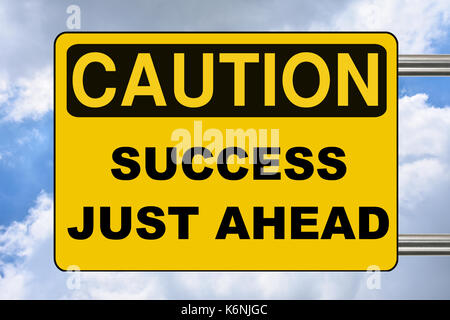 Success just ahead, yellow caution road sign - Stock Photo