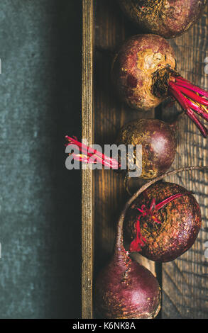 Raw organic purple beetroots in rustic wooden box, copy space - Stock Photo