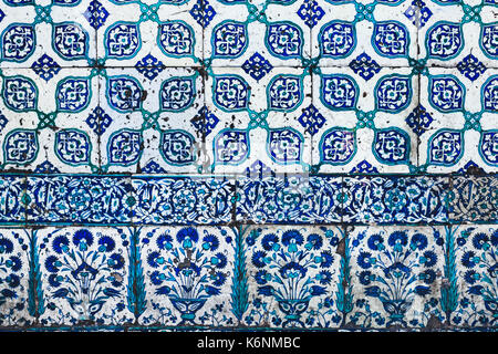 Seamless pattern white Turkish tiles with blue ornaments. Old surface texture, wall in mosque - Stock Photo