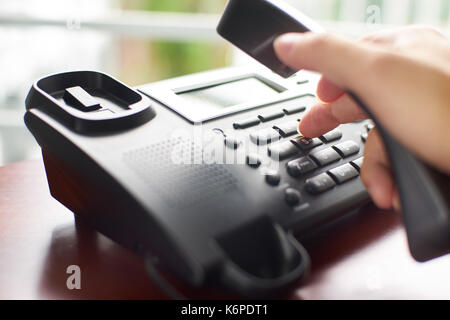 Telephone dialing ,contact and customer service concept . Selected focus . - Stock Photo