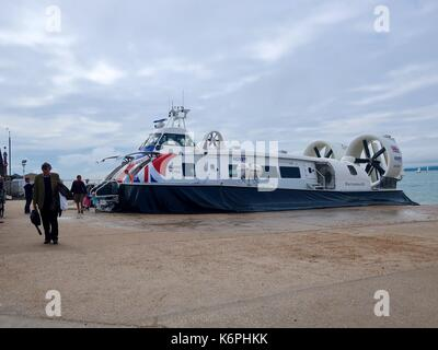 Passengers disembark the Island Flyer hovercraft after it travels across The Solent from Ryde on the Isle of Wight - Stock Photo