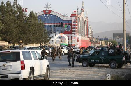 Kabul, Afghanistan. 13th Sep, 2017. Afghan security officers inspect the site of the attack in Kabul, Afghanistan, - Stock Photo