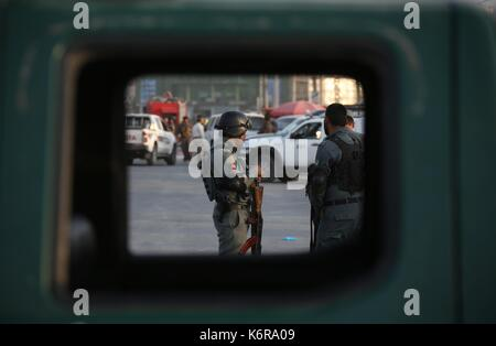 Kabul, Afghanistan. 13th Sep, 2017. Afghan security officers stand guard at the site of the attack in Kabul, Afghanistan, - Stock Photo