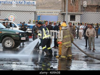 Kabul, Afghanistan. 13th Sep, 2017. Fire fighters work near the site of the attack in Kabul, Afghanistan, Sept. - Stock Photo