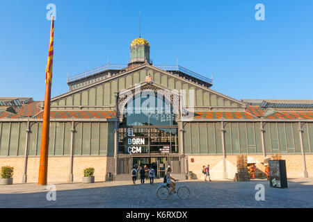BARCELONA, SPAIN - JUNE 1, 2017: The facade of Born market, and flag of Catalonia. It is an example of iron architecture, - Stock Photo