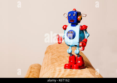 Vintage tin robot standing with surprise face - Stock Photo