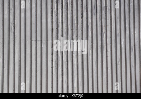 Urban background, white ruined industrial brick wall with copy space - Stock Photo