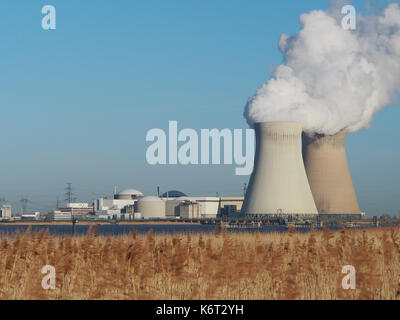 An overview of the site of the Doel Nuclear power plant with the two cooling towers photographed from the banks - Stock Photo