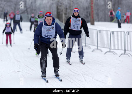 St. Petersburg, Russia - February 11, 2017: People participating in the mass ski race Ski Track of Russia during - Stock Photo