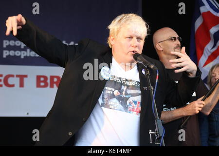 Boris Johnson impersonator Drew Galdron (aka 'Faux Bojo)' performs at an anti-Brexit rally in Parliament Square, - Stock Photo