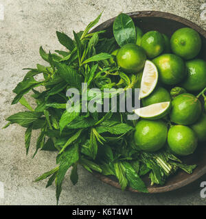 Flatlay of fresh limes and mint, top view, square crop - Stock Photo
