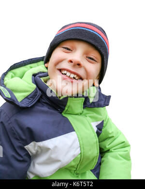A funny cheerful toddler boy in a warm jacket and hat smiling or laughing at beautiful autumn garden , close up, - Stock Photo