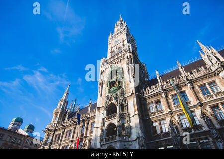 Beautiful super wide-angle sunny aerial view of Munich, Bayern, Germany with skyline and scenery beyond the city, - Stock Photo