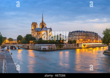Paris sunset city skyline panorama at Notre Dame de Paris Cathedral and Seine River, Paris, France - Stock Photo