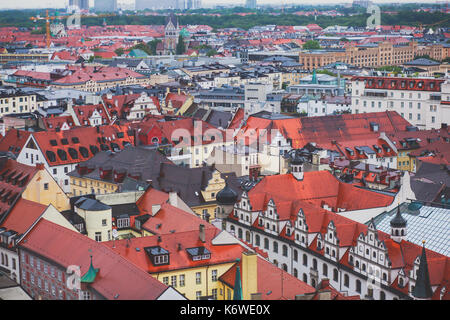 Beautiful super wide-angle sunny aerial view of Munich, Bayern, Bavaria, Germany with skyline and scenery beyond - Stock Photo