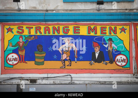 Cyclone CONEY ISLAND, NEW YORK, USA - MARCH 2017 - Freak show graffiti about the strong men. - Stock Photo