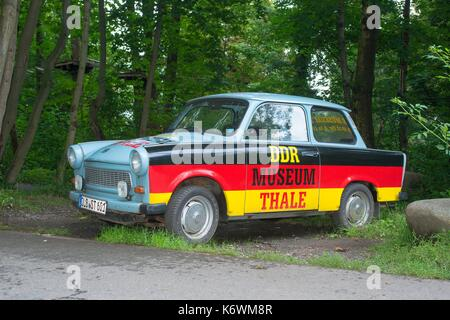 Old Trabant, Trabant at the roadside, varnished with Germany flag with inscription DDR-Museum Thale, advertising, - Stock Photo
