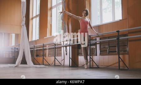 Graceful girl ballerina practicing in the Studio, elements of dance - Stock Photo
