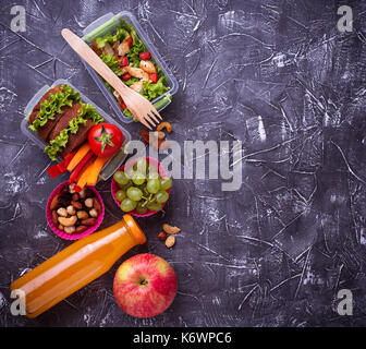 School lunch. Salad, sandwiches, fruits and nuts - Stock Photo