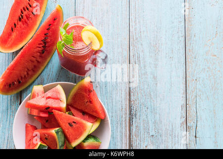 Watermelon smothie and slices with lime on balck background - Stock Photo